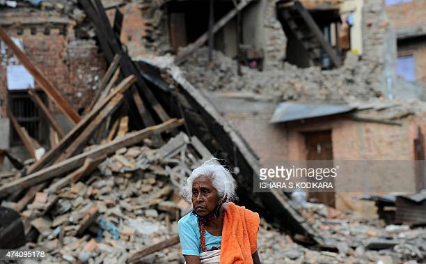 A Nepalese resident looks on near a collapsed house after an earthquake in Baktarpur on the outskirts of Kathmandu on May 20 2015 Nearly 8500 people...