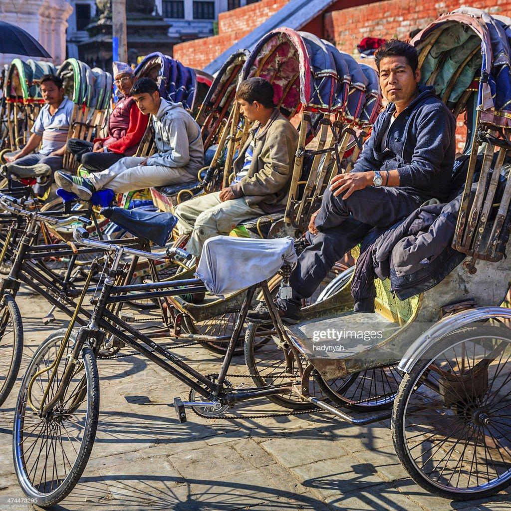 Nepalese rickshaws waiting for tourists on Durbar Square in Kathmandu : Stock Photo