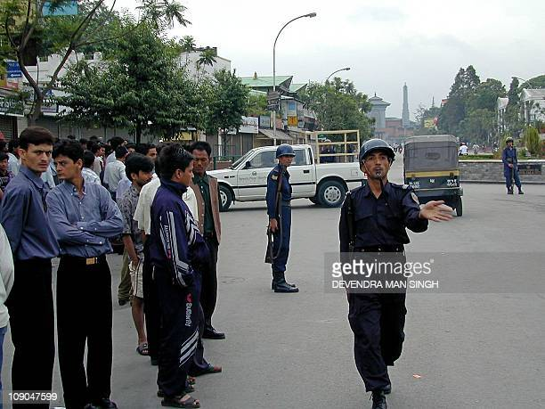 Nepalese riot police dispurse a crowd near the Royal Palace in Kathmandu 02 June 2001 following the fatal shooting of King Birendra of Nepal and...