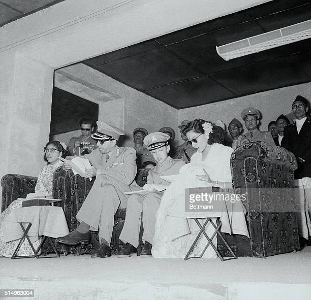 Nepalese royal family Kathmandu King Mahendra of Nepal left and the Queen with the Crown Prince seated between them look at the programmes of sports...