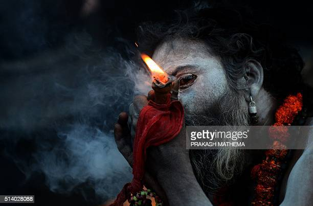 A Nepalese Sadhu Smokes A Chillum A Traditional Clay Pipe As A Holy Offering To Lord