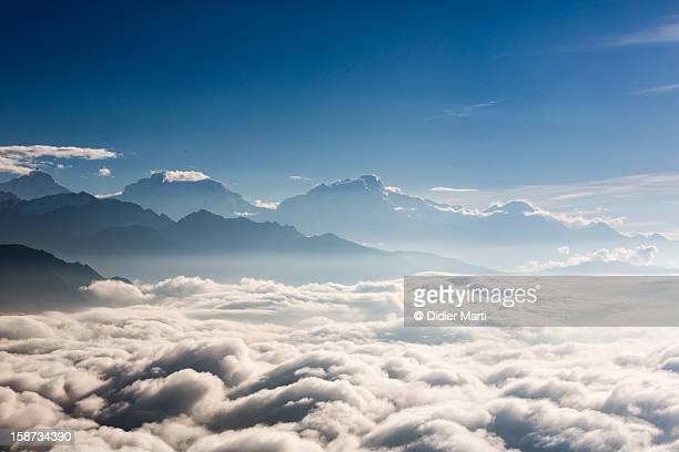 nepalese sea of clouds - didier marti stock photos and pictures