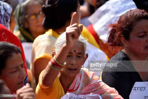 Nepalese senior citizen take part in the mass rally of 13yrs old Nirmala Panta who was raped and murdered 50 days ago in Kanchanpur district in...