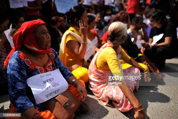 Nepalese senior citizens take part in the mass rally of 13yrs old Nirmala Panta who was raped and murdered 50 days ago in Kanchanpur district in...