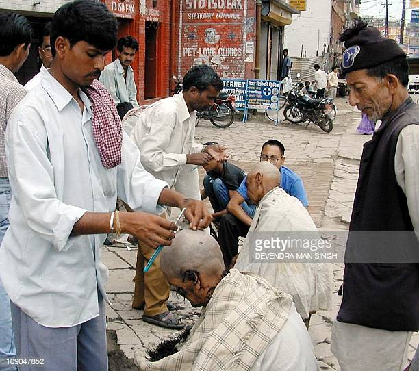 Nepalese shave their heads to mourn for the death of the King Birendra Queen Aishwarya and other royal family members in Kathmandu 03 June 2001 Nepal...