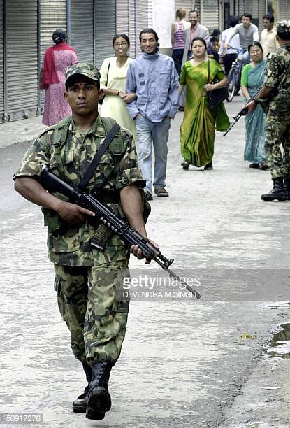 Nepalese soldier patrols a street in the area popular with foreign tourists Thamel in Kathmandu 02 June 2004 during a oneday general strike call by...