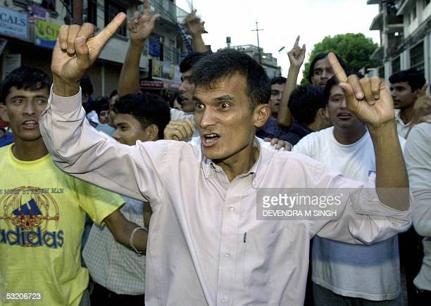 Nepalese students shout antimonarchy slogans as they take part in a demonstration to mark King Gyanendra's 59th birthday in a non restricted area of...