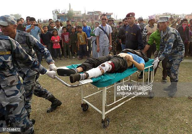 A Nepalese survivor of a plane crash is transported to a hospital in Kohalpur in Banke district some 550 kms west of Kathmandu on February 26 2016...