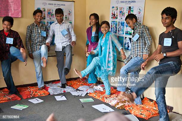 Nepalese teenagers stand on one foot during a life skills training session in Bisaneu Voice of Children centre in Kathmandu Nepal The session is part...