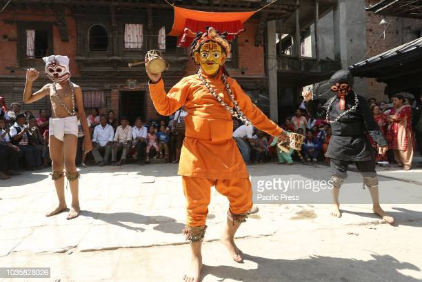 Nepalese traditional masked dancers perform Devi dance prior of Indrajatra festival in KathmanduNepal People worship Indraking of gods during the...