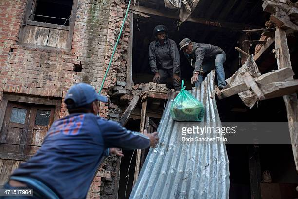 Nepalese victims of the earthquake collect their personal belongings on April 29, 2015 in Bhaktapur, Nepal. A major 7.8 earthquake hit Kathmandu...