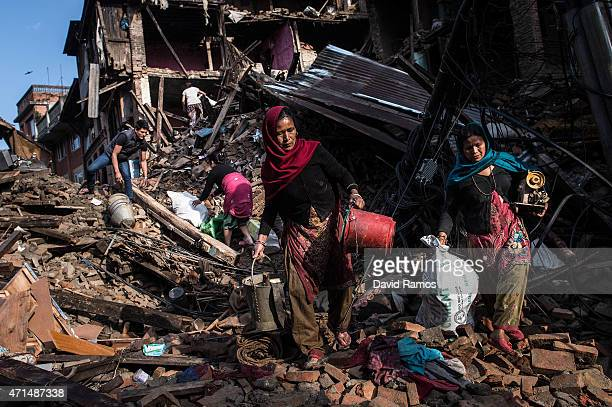 Nepalese victims of the earthquake search for their belongings among debris of their house on April 29, 2015 in Bhaktapur, Nepal. A major 7.8...