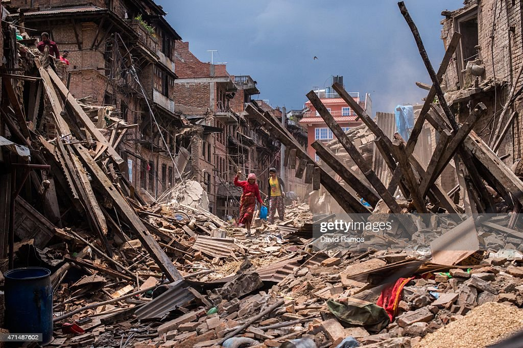 Nepalese victims of the earthquake search for their belongings among debris of their homes on April 29, 2015 in Bhaktapur, Nepal. A major 7.8 earthquake hit Kathmandu mid-day on Saturday, and was followed by multiple aftershocks that triggered avalanches on Mt. Everest that buried mountain climbers in their base camps. Many houses, buildings and temples in the capital were destroyed during the earthquake, leaving over 4600 dead and many more trapped under the debris as emergency rescue workers attempt to clear debris and find survivors. Regular aftershocks have hampered recovery missions as locals, officials and aid workers attempt to recover bodies from the rubble.
