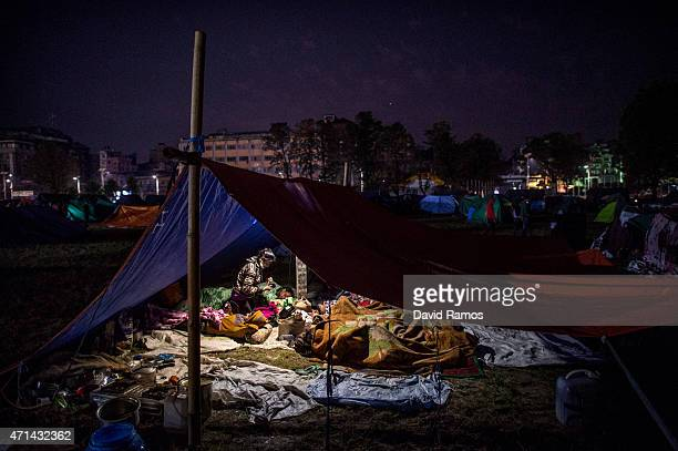 Nepalese victims of the earthquake sleep under their makeshift at Tunshikel park on April 28, 2015 in Kathmandu, Nepal. A major 7.8 earthquake hit...