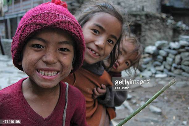 nepalese village childrens smiling - nepalese ethnicity stock pictures, royalty-free photos & images