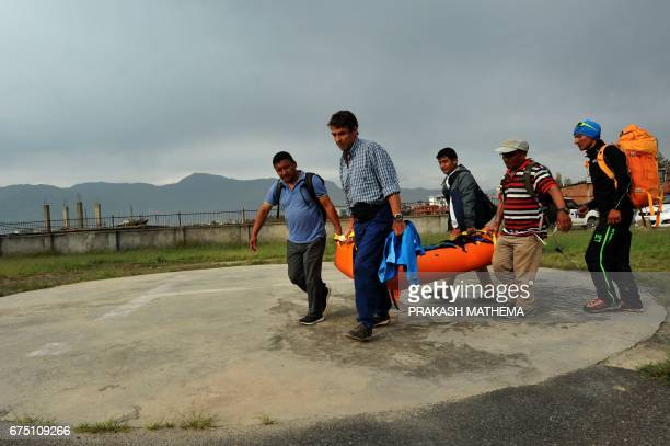 Nepalese volunteers and friends of Swiss climber Ueli Steck carry his body at a hospital in Kathmandu on April 30 2017 Swiss climber Ueli Steck one...