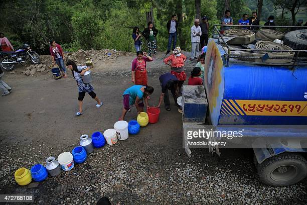 Nepalese wait to fill buckets with water in Bungamati neighborhood Kathmandu, Nepal on May 9, 2015. The number of the dead in the aftermath of...