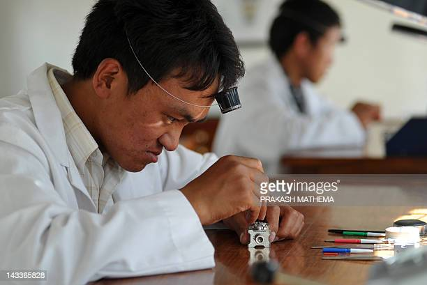 Nepalese watchmaker Ang Namgel Sherpa and Lakpa Thundu Sherpa work on timepieces at the Kobold watch workshop in Kathmandu on April 25 2012 AFP...