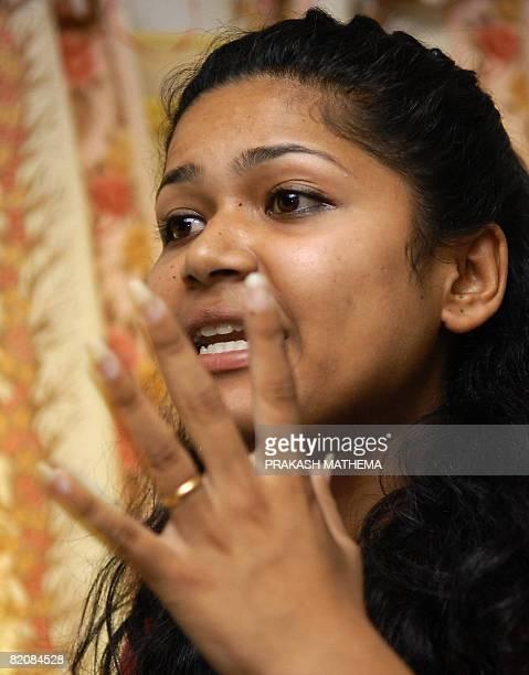 Nepalese woman Nihita Biswas, the fiancee of convicted murderer Charles Sobhraj, speaks to journalists during press meet in Kathmandu on July 28,...