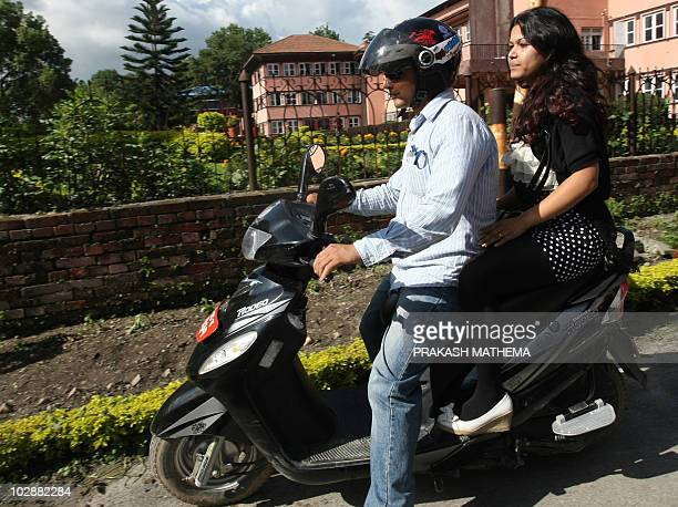 """Nepalese woman Nihita Biswas who reportedly married """"Bikini Killer"""" Charles Sobhraj in prison two years ago, leaves the Supreme Court on the back of..."""