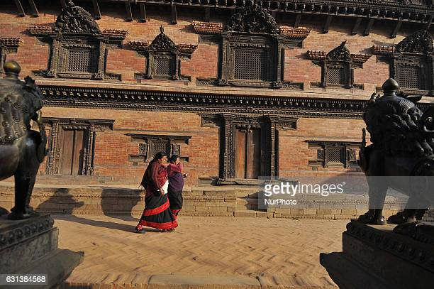 Nepalese woman travelling towards home after offering ritual prayer on the morning at the premises of Bhaktapur Durbar Square Bhaktapur Nepal on...
