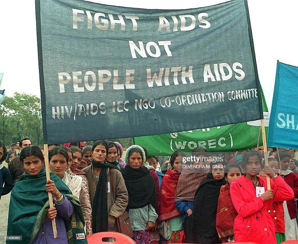 Nepalese women from different walks of life march in a rally with banners to celebrate the 10th World AIDS Day in Kathmandu 01 December. The rally was joined by school boys and girls, including International Non-governmental Organizations, intellectuals and doctors. AFP PHOTO Devendra M. SINGH.