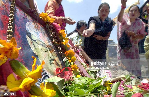 Nepalese women light insences while they pray for their beloved King Birendra and his family members who were killed during the royal palace massacre...