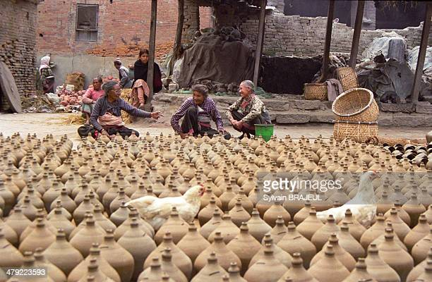 CONTENT] Nepalese women making some potteries in the old city of BhaktapurKathmandu Valley Nepal