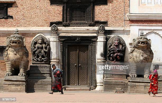 Nepalese women pass through the Bhaktapur Durbar Square in Bhaktapur some of 12 kilometers southeast of Kathmandu on March 24 2010 AFP PHOTO/Prakash...