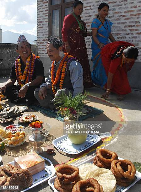 Nepalese women pay respects to their brothers on the occasion of Bhai Tika brothers' worship on the last day of the Hindu festival of Tihar in...