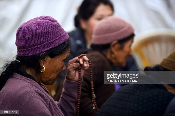 Nepalese women pray in the monastery where the remains of Jigme Dorje Palbar Bista the last king of former Himalayan kingdom of Mustang is kept at...