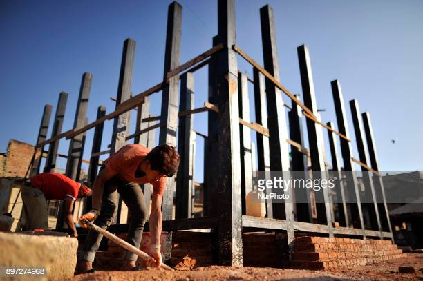 Nepalese workers renovating the temple of Rato Machindranath temple at Bungamati on Friday December 22 2017 On April 25 2015 Earthquake disaster...