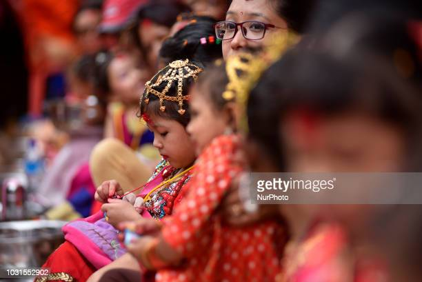 A Nepalese young girl impersonate as a Kumari or living Goddess participate in the ritual during celebration of Kumari puja at Basantapur Durbar...