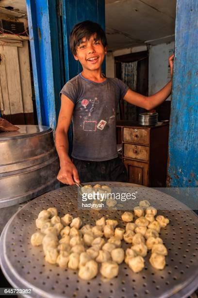 Nepalese young street vendor selling momos (dumplings), Bhaktapur