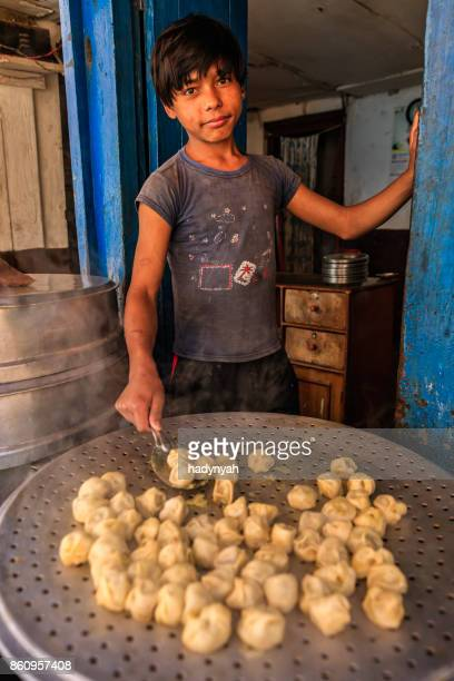 nepalese young street vendor selling momos (dumplings), bhaktapur - child labour stock pictures, royalty-free photos & images