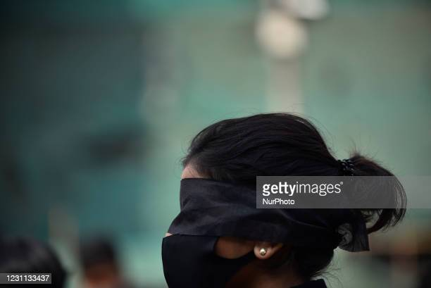 Nepalese youth activist cover eyes using cloth in the mass rally against woman violence and rising rape cases in Kathmandu, Nepal on Friday, February...