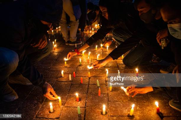 Nepalese youth attends a candlelight vigil for those who died in protests during Myanmar's military coup in Kathmandu, Nepal on March 31, 2021.