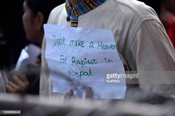 A Nepalese youth hold placards and chants slogans in the mass rally of 13yrs old Nirmala Panta who was raped and murdered 50 days ago in Kanchanpur...