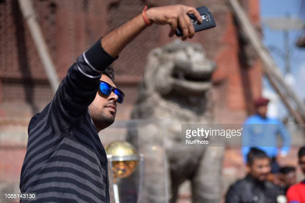A Nepalese youth takes selfie along with the 2019 ICC Cricket World Cup trophy in Basantapur Durbar Square during a country tour in Kathmandu Nepal...