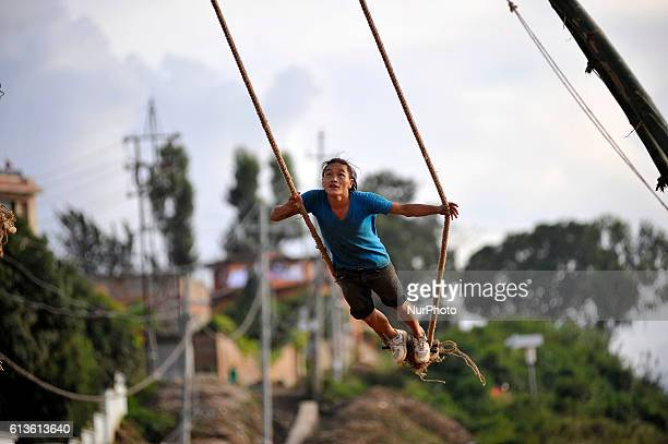 A Nepalese youth tries after making traditional bamboo ping or swing for dashain festival celebration at Sanepa Kathmandu Nepal on Sunday October 09...