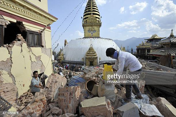 Nepalese youth volunteers collect belongings from a damaged house at Swayambhunath stupa in Kathmandu on May 2 2015 Nepal has ruled out the...