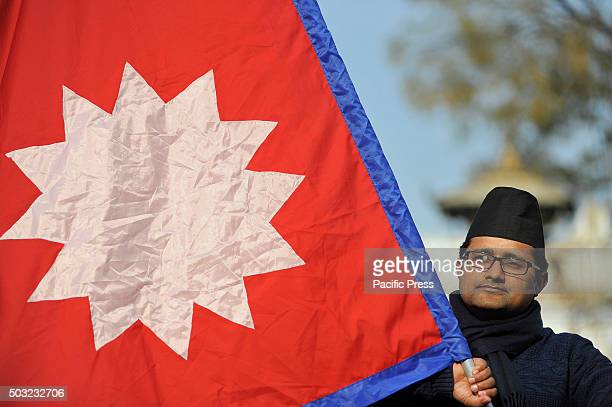 Nepalese youth weaving National Flag and wearing Nepalese traditional DhakaTopi during the celebration of Nepalese National Nepali Traditional Topi...