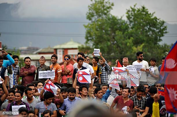 Nepalese youths display slogans quotes placard during solidarity to Prime Minister Khadga Prasad Sharma Oli at Maitighar Mandala Kathmandu Nepal on...