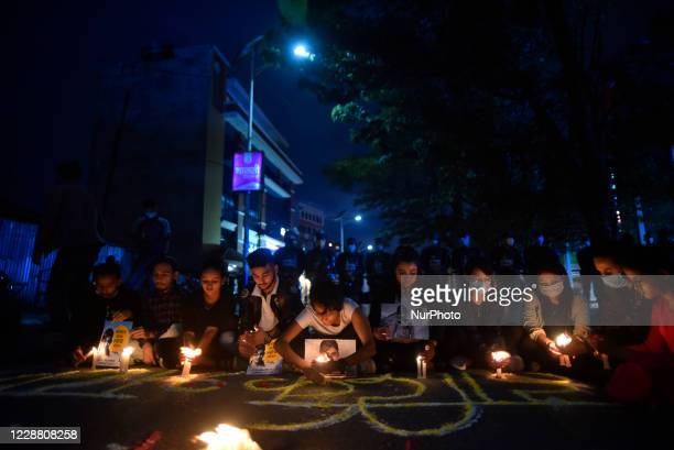 Nepalese youths participate in a candle light vigil demanding investigation and justice on the memory of Nirmala Panta and Samjhana Kami who was...