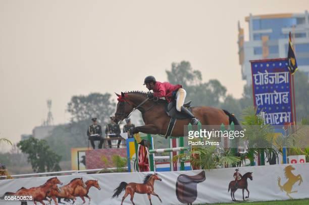 TUDIKHEL KATHMANDU NEPAL KATHMANDU NEPAL Nepaleses army horse cavalry perform horse riding skills during Ghode Jatra or the 'Festival of Horse'...