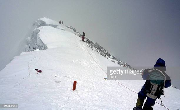 NepalEverestenvironmentclimbing FOCUS by Deepesh Shrestha In this May 19 2009 file photograph unidentified mountaineers descend Mount Everest A group...