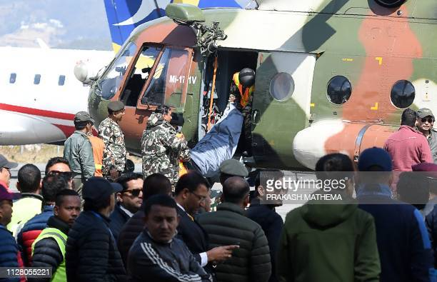 Nepali army carry bodies of the victims of a helicopter crash including Nepal's tourism minister Rabindra Adhikari at Tribhuvan domestic Airport in...