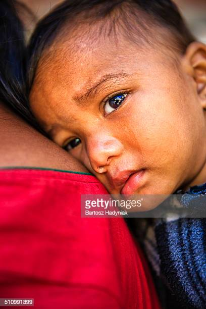 nepali baby carrying by mother - nepali mother ストックフォトと画像