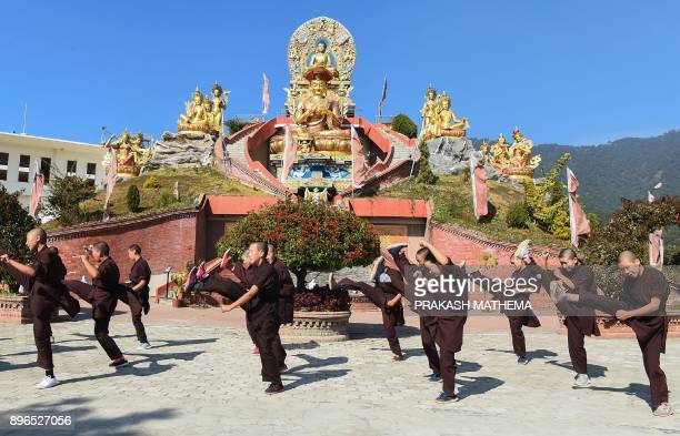 Nepali Buddhist nuns practise kung fu at the Amitabha Drukpa Nunnery on the outskirts of Kathmandu on December 21 2017 / AFP PHOTO / PRAKASH MATHEMA