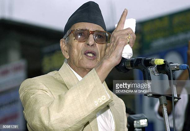 Nepali Congress Leader Girija Prasad Koirala gestures as he addresses a public meeting at Ratna Park in front of The Royal Palace in Kathmandu 21...